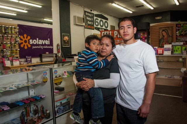 Hedy Julca was arrested inside her store while her 3-year-old son watched from close by. Her son Diego Lobaton, right, was detained by officers outside the store.